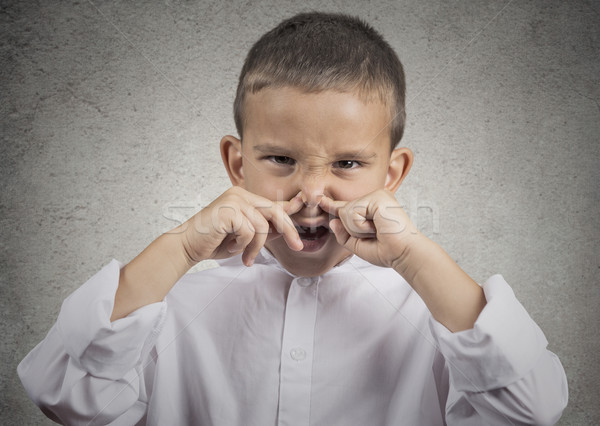 boy disgust on face pinches nose something stinks Stock photo © ichiosea