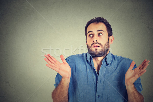 young man shrugging shoulders who cares so what I don't know Stock photo © ichiosea