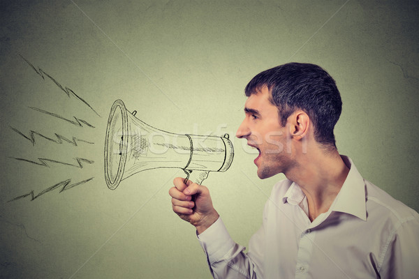 Side profile business man shouting into a megaphone isolated on gray background  Stock photo © ichiosea