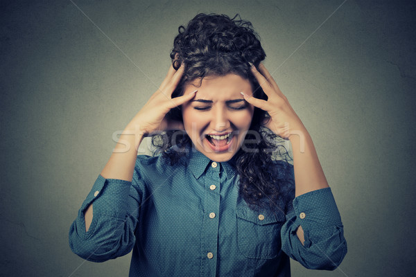 stressed frustrated young woman yelling screaming Stock photo © ichiosea