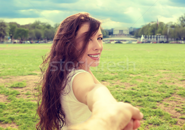 Happy woman in Washington DC downtown extending you an arm inviting to visit Lincoln Memorial Stock photo © ichiosea