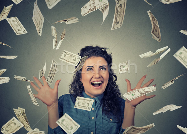 woman exults pumping fists ecstatic celebrates success under money rain falling down dollar bills ba Stock photo © ichiosea