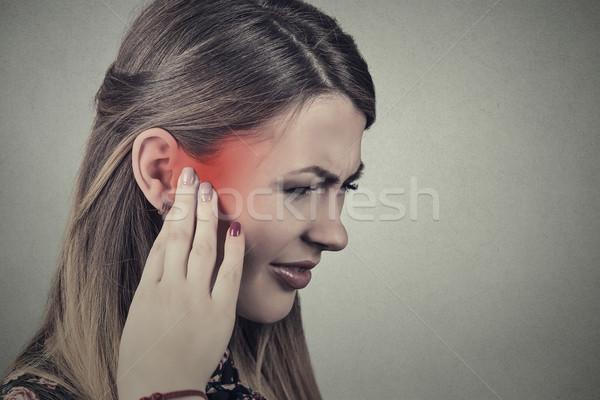 Tinnitus. Closeup side profile sick young woman having ear pain  Stock photo © ichiosea
