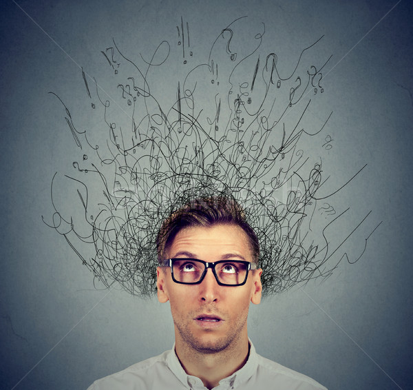 man with worried face expression brain melting into lines question marks  Stock photo © ichiosea