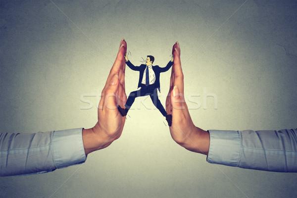 man between hands resisting pressure  Stock photo © ichiosea