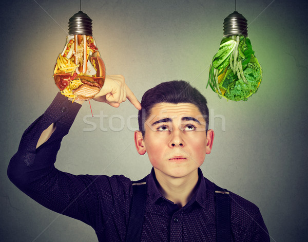 man thinking looking up at junk food vegetables light bulb Stock photo © ichiosea