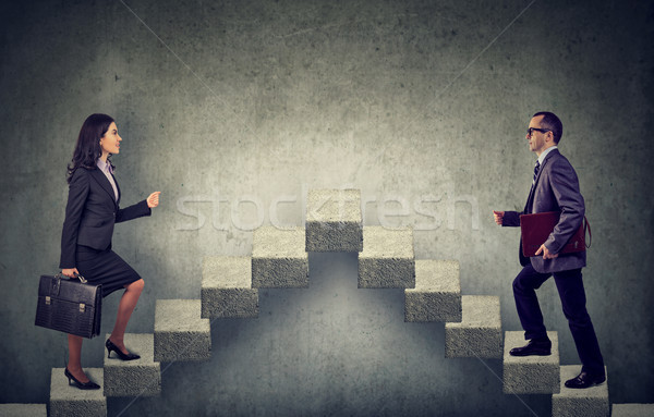 Young business woman and man stepping up a stairway career ladder  Stock photo © ichiosea