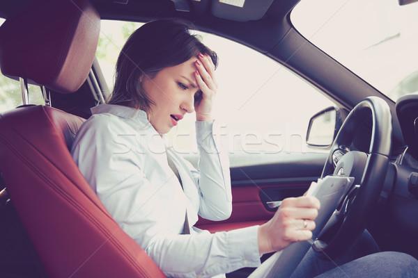 Desesperado mujer conductor documentos sesión Foto stock © ichiosea