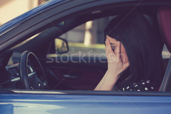 Stressed woman driver sitting inside her car  Stock photo © ichiosea