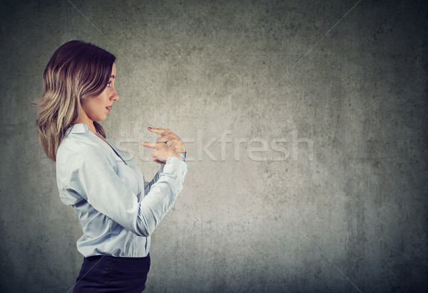 Surprised woman pointing fingers at herself being misunderstood  Stock photo © ichiosea