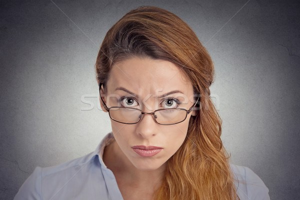 Skepticism. Angry grumpy doubtful woman looking at you  Stock photo © ichiosea