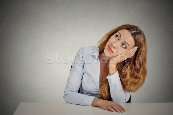 Portrait woman leaning on a white desk, thinking Stock photo © ichiosea