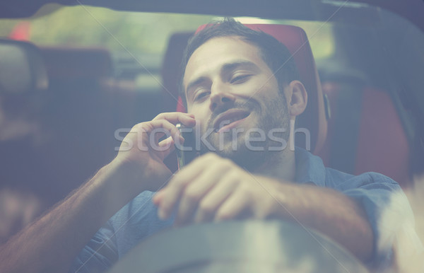 handsome young man talking on mobile phone while driving his car Stock photo © ichiosea