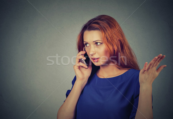 upset sad, unhappy, serious woman talking on phone displeased with conversation  Stock photo © ichiosea