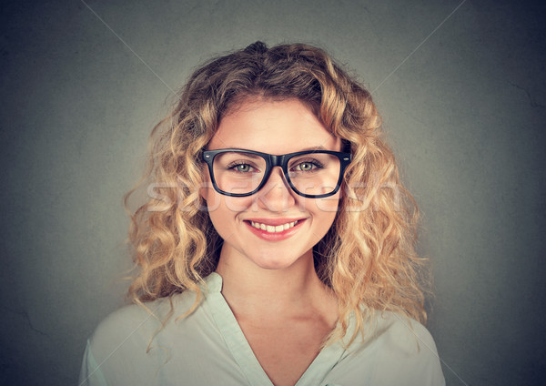 Headshot of a happy smiling woman in glasses  Stock photo © ichiosea
