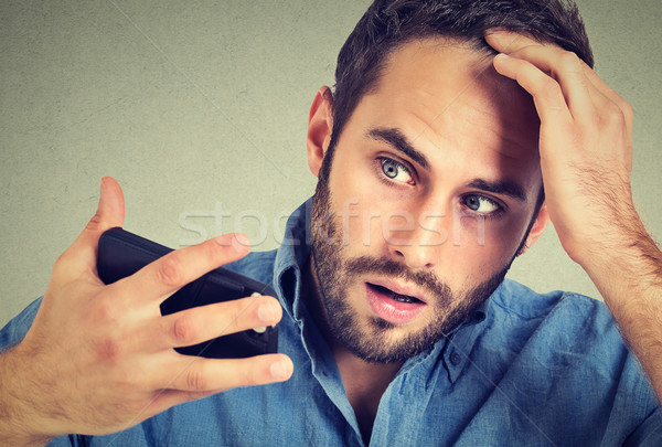 portrait, shocked man feeling head, surprised he is losing hair Stock photo © ichiosea