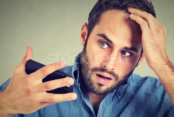 Retrato conmocionado hombre sentimiento cabeza sorprendido Foto stock © ichiosea