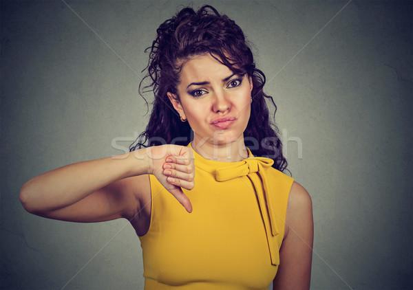 Kobieta kciuk w dół gest patrząc negatywne Zdjęcia stock © ichiosea