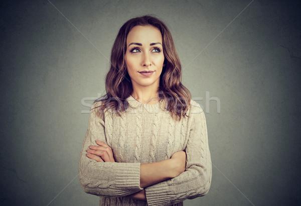 Kadın bakıyor poz gri genç model Stok fotoğraf © ichiosea