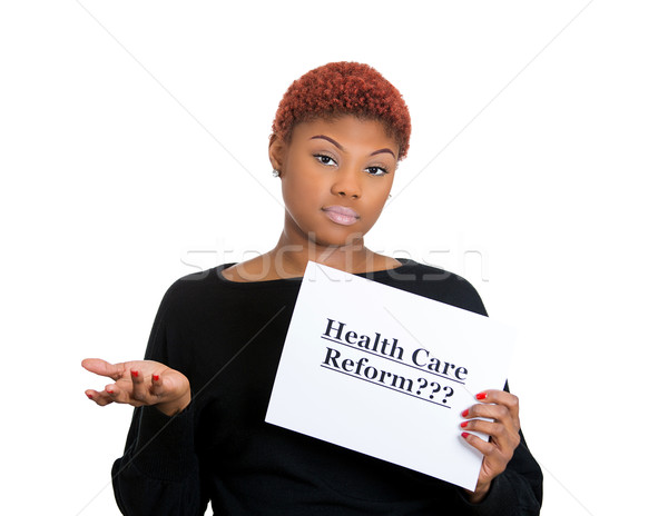 Woman holding health care reform sign Stock photo © ichiosea