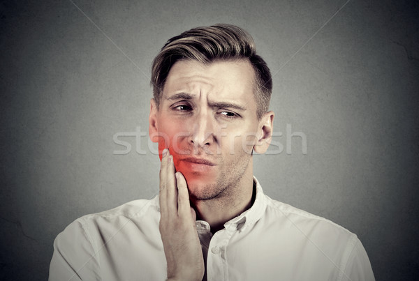 Man with sensitive toothache problem about to cry from pain  Stock photo © ichiosea