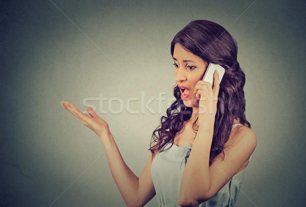 Sconvolto arrabbiato infelice grave donna parlando Foto d'archivio © ichiosea