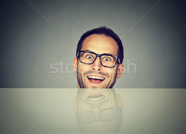surprised business man hiding under the table blank billboard Stock photo © ichiosea