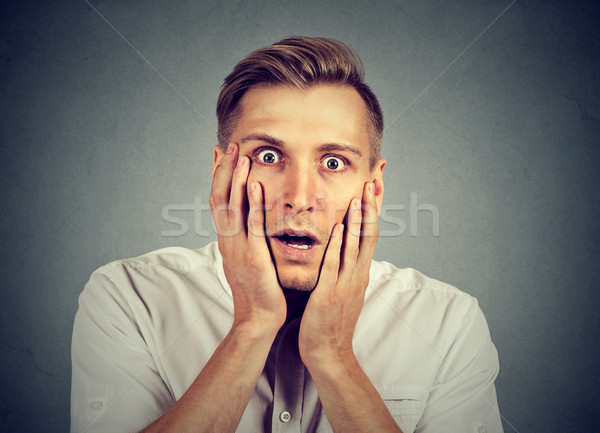 shocked young man with open mouth  Stock photo © ichiosea