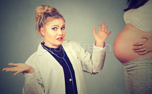 clueless health care professional, has no answer for pregnant woman, doesn't know Stock photo © ichiosea