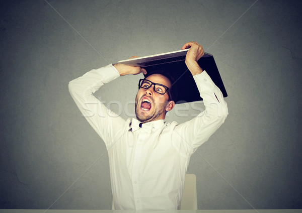 furious nervous business man about to smash throw his laptop computer Stock photo © ichiosea