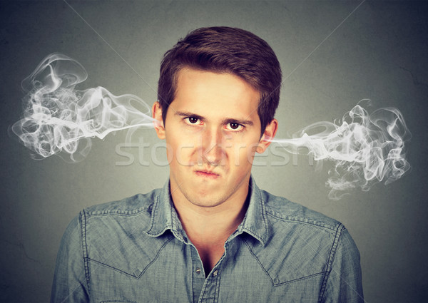 angry young man, blowing steam coming out of ears Stock photo © ichiosea
