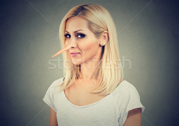 Smiling cunning woman with long nose. Liar concept. Face expressions, emotions, feelings Stock photo © ichiosea