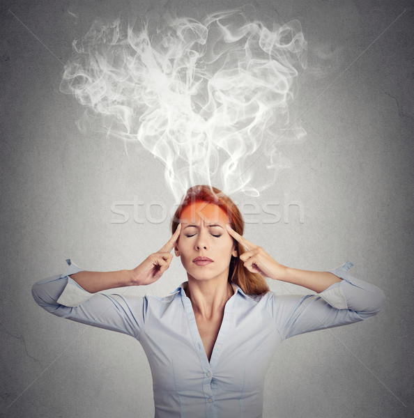 woman thinking too hard steam coming out up of head  Stock photo © ichiosea