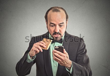 angry middle aged business man on a phone Stock photo © ichiosea