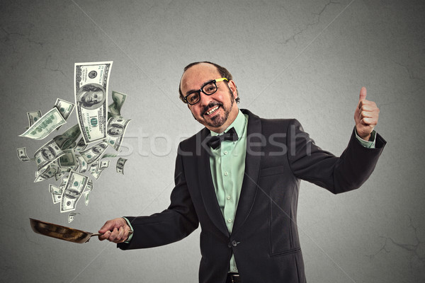 Middle age businessman juggling money dollar bills  Stock photo © ichiosea
