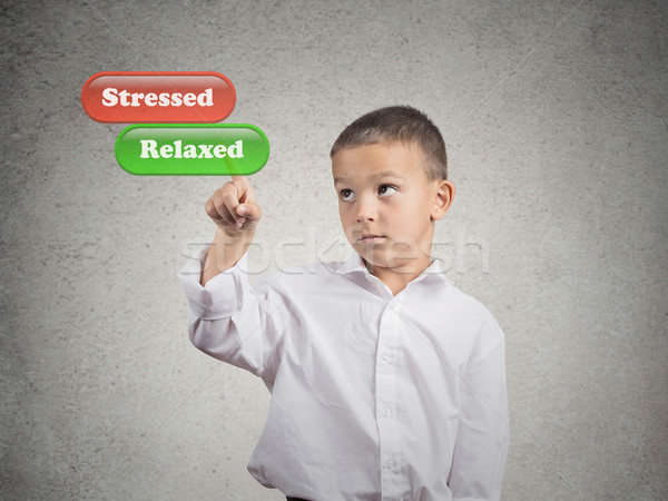 Boy pushing relaxed button mode on touch screen dispaly Stock photo © ichiosea