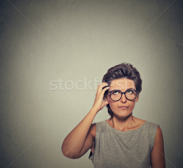 Confused thinking woman in glasses bewildered scratching her head Stock photo © ichiosea