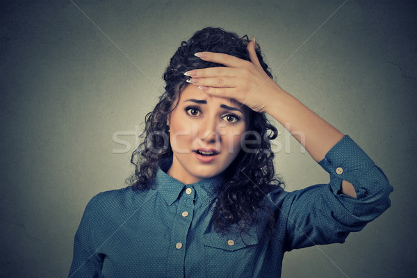 woman looking shocked, surprised, hand on head stressed realized mistake Stock photo © ichiosea
