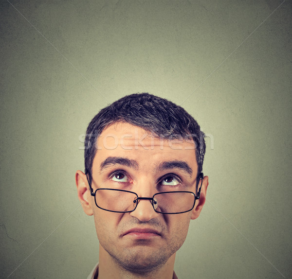 funny confused skeptical man in glasses thinking planning looking up Stock photo © ichiosea