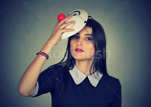 Young woman taking off a mask.  Stock photo © ichiosea