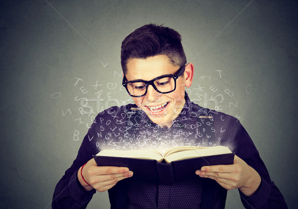 man reading a book with alphabet letters coming out  Stock photo © ichiosea