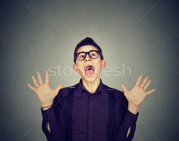 Surprised excited funky looking man screaming  Stock photo © ichiosea