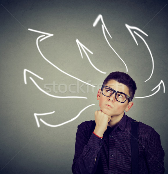 Confused, young business man with many twisted arrows  Stock photo © ichiosea