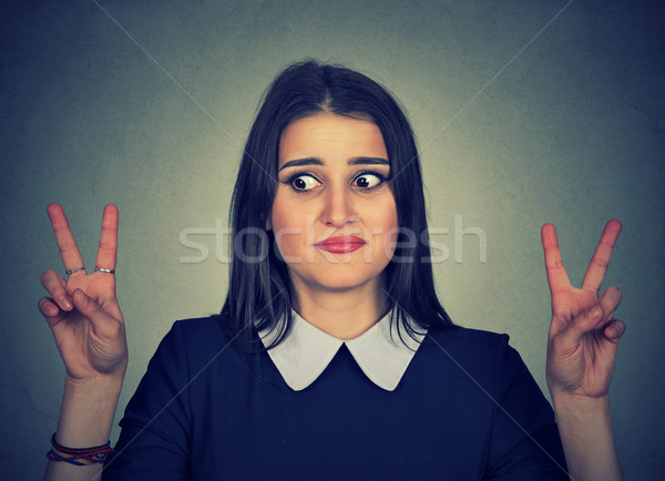 Doubtful confused woman with victory sign   Stock photo © ichiosea
