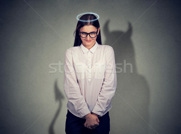 Shy quiet angel woman with devil character  Stock photo © ichiosea