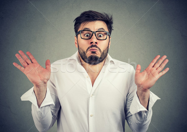 Ignorant man shrugging with shoulders Stock photo © ichiosea