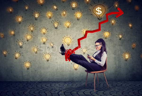 accomplished business woman relaxing sitting in the office under idea money rain Stock photo © ichiosea