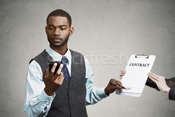 Stock photo: Corporate executive signing contract,  holding, reading news fro