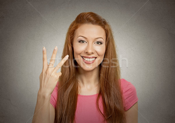 woman giving three fingers gesture Stock photo © ichiosea
