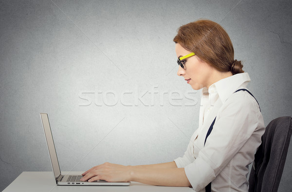 woman with glasses using her laptop Stock photo © ichiosea
